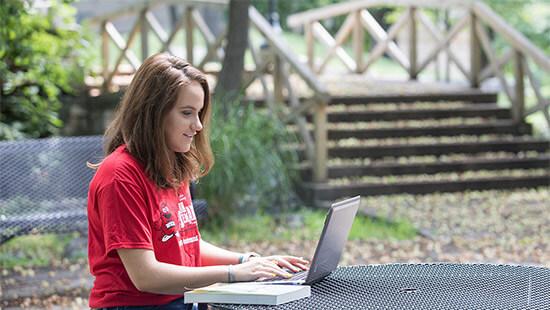 WKU student studying outside