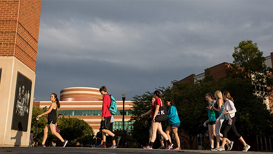 WKU students walking outside of the School of Media